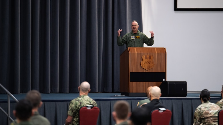Adm. Charles Richard, U.S. Strategic Command commander, addresses the crowd during the presentation of the Omaha Trophy to the 96th Bomb Squadron at Barksdale Air Force Base, Louisiana, March 30, 2021. The Omaha Trophy is awarded each year to various units in recognition of outstanding support to USSTRATCOM's strategic deterrence mission. (U.S. Air Force photo by Airman 1st Class Jacob B. Wrightsman)