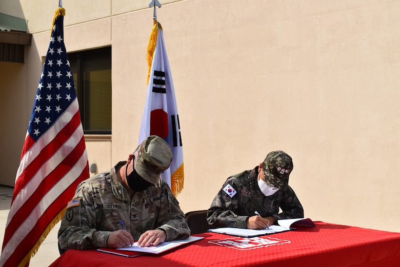 Captured is the new Army storage warehouse staging and loading docks, which was turned over to Col. Garrett Cottrell, Deputy Commanding Officer - Transformation, U.S. Army Corps of Engineers Far East District, on behalf of the U.S. government by Col. Pyo In Tae, ROK Design and Construction Agent, on behalf of the ROK government during the Acceptance Release Letter signing at USAG Humphreys, Republic of Korea, Apr. 2, 2021.