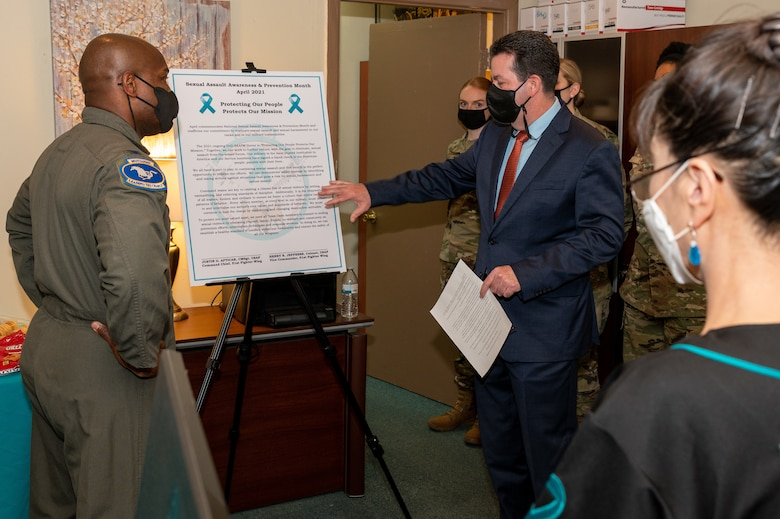 U.S. Air Force Col. Henry Jeffress, 51st Fight Wing vice commander, left, and Richard Coyle, 51st Fighter Wing Sexual Assault Prevention and Response program manager, right, review the SAPR proclamation at Osan Air Base, Republic of Korea, April 1, 2021. The Department of Defense observes Sexual Assault Awareness and Prevention Month by focusing on creating and cultivating a culture to eliminate sexual assault. (U.S. Air Force photo by Senior Airman Branden Rae)
