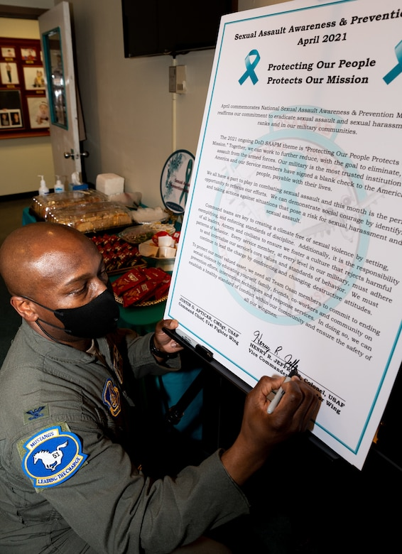 U.S. Air Force Col. Henry Jeffress, 51st Fight Wing vice commander, signs a Sexual Assault Awareness and Prevention Month proclamation at Osan Air Base, Republic of Korea, April 1, 2021. The Department of Defense formally created the SAPR program in 2005. (U.S. Air Force photo by Senior Airman Branden Rae)