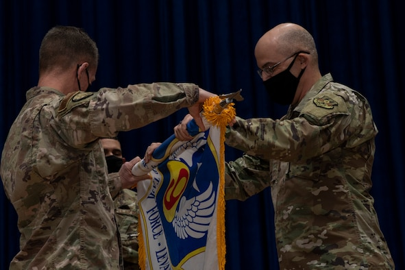 U.S. Air Force Maj. Gen. Kenneth P. Ekman, deputy commander of operations, Combined Joint Task Force-Operation Inherent Resolve, and commander, 9th Air Force Expeditionary Task Force-Levant, U.S. Air Forces Central, and Chief Master Sergeant James Fitch, command chief, 9 AETF-L, case the unit's colors during an inactivation ceremony, April 1, 2021 at Ali Al Salem Air Base, Kuwait. The 9 AETF-L focused U.S. Air Force airpower to militarily defeat Daesh in Iraq and Syria in support of the CJTF-OIR. (U.S. Air Force photo by Senior Airman Kristine Legate)