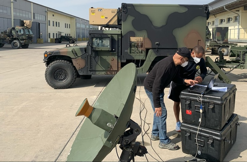 Hector Cerrato shows Staff Sgt. Sidney Johnson, a military intelligence Soldier assigned to 2nd Cavalry Regiment, how to set up at Global Broadcast Service system in a Tactical Intelligence Ground Station. The GBS is a one-way broadcast capability supporting timely delivery of unclassified and classified video, large quantities of unclassified or classified digital data and other theater information transfer needs for the Army, The GBS is deployed and used worldwide. 