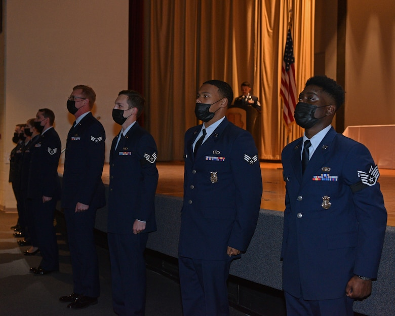 Graduates of Airman Leadership School Class 21-C prepare to sing the Air Force Song during the ALS Graduation ceremony in the Base Theater on Goodfellow Air Force Base, Texas, April 1, 2021. The graduation of ALS marks completion of the first enlisted professional military education course. (U.S. Air Force photo by Senior Airman Ashley Thrash)