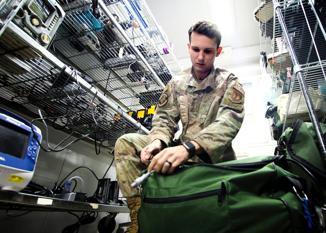 U.S. Air Force Tech Sgt. Adam Cardoza, Noncommissioned Officer in charge, Pulmonary Clinic, Landstuhl Regional Medical Center, performs a preflight inspection on equipment as part of the 86th Medical Squadron's Critical Care Air Transport Team operations, March 23. Cardoza, a native of Dana Point, California, was recognized as the Air Force's top Cardiopulmonary Laboratory Noncommissioned Officer of the Year of 2020.