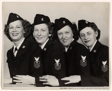 """A 1944 photo of four SPAR CPOs:  Left to right: Judith Balinsky, Chief Yeoman, of Akron; Leone Peppard, Chief Storekeeper, of Grand Forks, North Dakota; Leta Belgard, Chief Storekeeper, of Fairport, New York, and Frances Brown, Chief Yeoman, of San Francisco."""""""