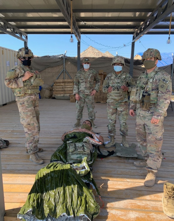 U.S. Soldiers with the 1-82nd Attack Reconnaissance Battalion perform medical training at an airfield in their area of operations in the Middle East. Formally called Tactical Combat Casualty Care, this training ensures Soldiers have the ability to save lives when necessary.