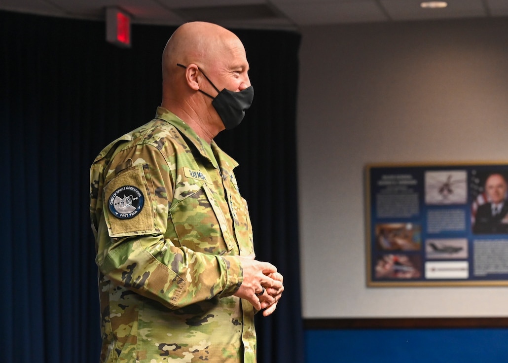 military member speaking to a crowd