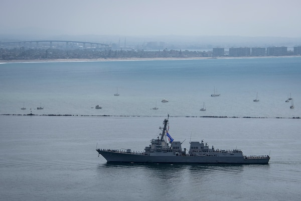 Arleigh Burke-class guided-missile destroyer USS John Finn (DDG 113) returns to Naval Base San Diego.