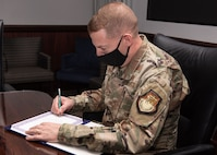 Peterson-Schriever Garrison commander signs Month of the Military Child Proclamation