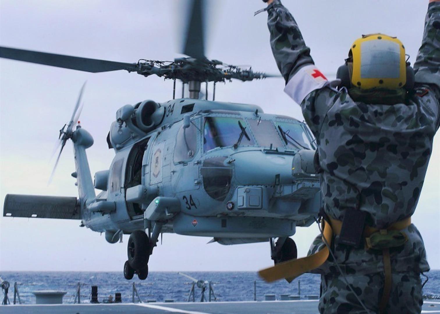 Australian sailors launch Sea Hawk helicopters aboard USS John Finn
