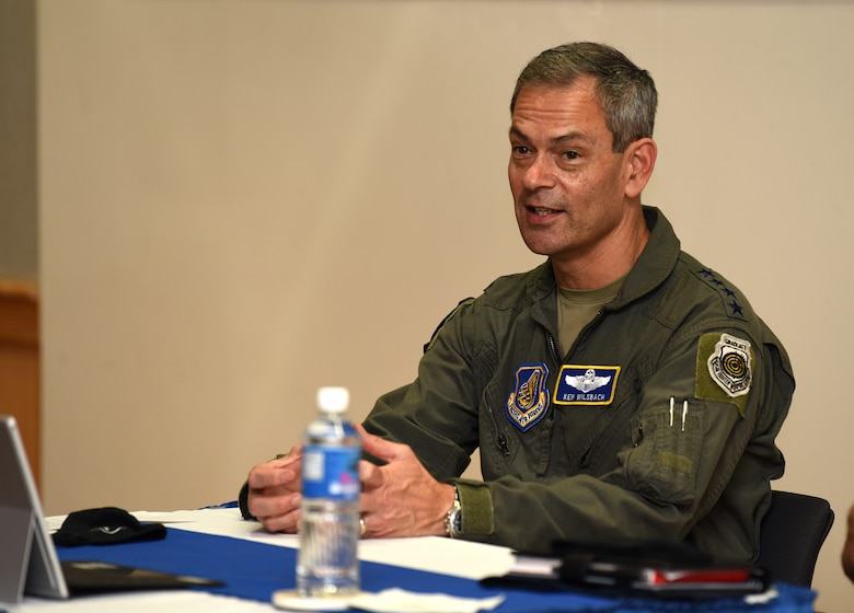 U.S. Air Force Gen. Ken Wilsbach, Pacific Air Forces (PACAF) commander, discuss command priorities with Airmen from around the Pacific during Pacific Paladin at the Aloha Conference Center, Joint Base Pearl Harbor-Hickam, Hawaii, March 31, 2021. Pacific Paladin, a new PACAF professional development platform focused on mentoring staff sergeants through senior master sergeants, bridging the gap between the tactical, operational and strategic level of performance. More than 200 Airmen from nine PACAF installations attended the seminar in-person and virtually. (U.S. Air Force photo by Tech. Sgt. Zachary Vaughn)