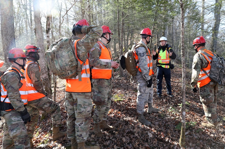 Nathan Kirby, London-Laurel Rescue Squad leader and public information officer, shares tips on looking for people with members of the Kentucky National Guard during search and rescue training in the hills of Daniel Boone National Forest. The training was held March 27-30, 2021.