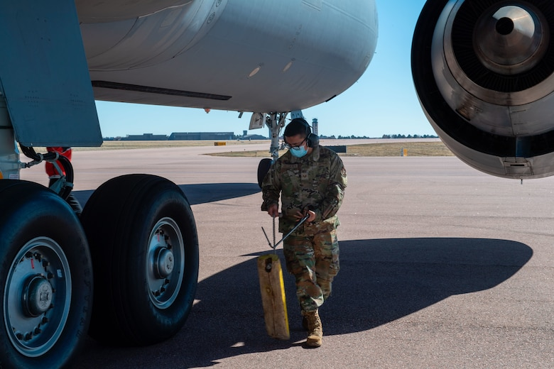U.S. Air Force Staff Sgt. Angel Delgadillo, a communications navigation technician with the 714th Aircraft Maintenance Squadron, pulls chalks prior to a flight from Colorado to Joint Base McGuire-Dix-Lakehurst, New Jersey. Reservists with the 514th AMW fly and maintain both KC-10 Extenders and C-17 Globemaster IIIs. (U.S. Air Force photo by Tech. Sgt. Monica Ricci)