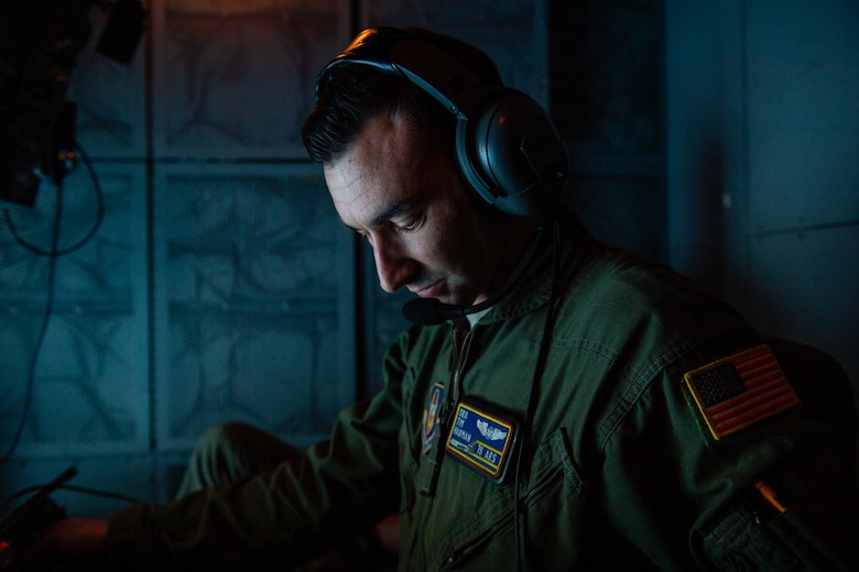 U.S. Air Force Senior Airman Tim Harman, a boom operator with the 76th Air Refueling Squadron prepares for a scheduled in-air refueling on a KC-10 Extender during a training mission March 31, 2021.Reservists with the 514th AMW fly and maintain both KC-10 Extenders and C-17 Globemaster IIIs. (U.S. Air Force photo by Tech. Sgt. Monica Ricci)