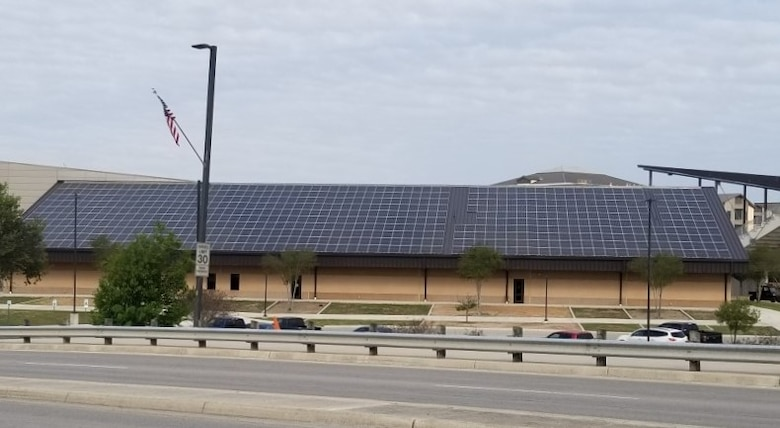 A Department of Energy, Energy Saving Performance Contract project at Joint Base San Antonio involves the installation of solar energy systems on 55 buildings, including the Pfingston Reception Center at JBSA-Lackland, at the cost of about $46 million. Systems will be installed on JBSA-Lackland, -Kelly Annex, -Chapman Training Annex, and -Fort Sam Houston