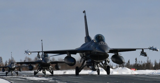 U.S. Air Force F-16's from the Minnesota Air National Guard's 148th Fighter Wing arrive at Yellowknife, Canada during North American Aerospace Defense Command's Arctic air defense exercise, Amalgam Dart 21-02, March 20, 2021.