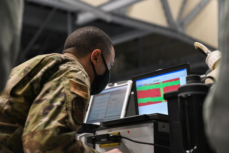 Senior Airman Harry Fraticelli, 319th Aircraft Maintenance Squadron nondestructive inspection craftsman, checks for cracks and defects on an RQ-4 Global Hawk using the image produced from a mobile automated scanner system on Grand Forks Air Force Base, N.D., March 25, 2021. Fraticelli has trained multiple Airmen in the 319 AMXS NDI shop to be certified to lead a MAUS inspection on the RQ-4 Global Hawk. (U.S. Air Force photo by Airman 1st Class Ashley Richards)