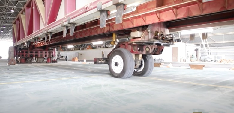 The U.S. Army Corps of Engineers Research and Development Center's Geotechnical and Structures Laboratory uses a Heavy Vehicle-load Simulator-Aircraft system to test AM2 matting for the U.S. Navy's P-8 Poseidon aircraft in March 2021 at the Waterways Experiment Station in Vicksburg, Mississippi.