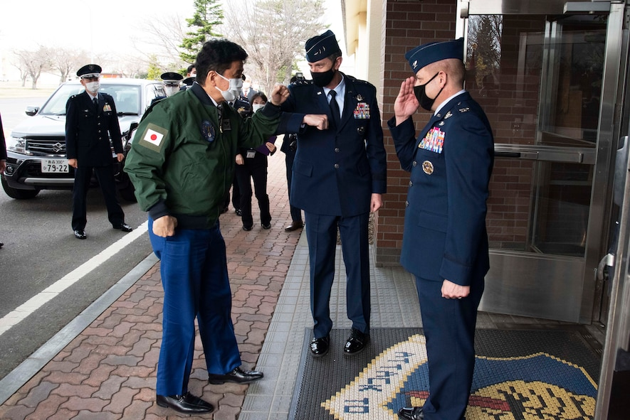 Japan Minister of Defense, Nobuo Kishi, is greeted by Lt. Gen. Kevin Schneider, U.S. Forces Japan and 5th Air Force commander, and saluted by Col. Jesse Friedel, 35th Fighter Wing commander, during a visit at Misawa Air Base on April 3, 2021. During the visit, Minister of Defense Kishi received briefings about the F-16 Fighting Falcon, and the 35th FW's mission to defend Japan with advanced Suppression of Enemy Air Defense and Destruction of Enemy Air Defense capabilities. SEAD and DEAD capabilities are critical to maintaining credible deterrence and defense in the Indo-Pacific region. (U.S. Air force photo by Maj. Cody Chiles)