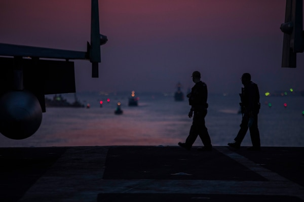 SUEZ CANAL (April 2, 2021) Master-at-Arms 1st Class Andrew Eickholt, left, and Airman Edwin Rivera stands security watch on the flight deck as the aircraft carrier USS Dwight D. Eisenhower (CVN 69) transits the Suez Canal, April 2. The Eisenhower Carrier Strike Group is deployed to the U.S. 5th Fleet area of operations in support of naval operations to ensure maritime stability and security in the Central Region, connecting the Mediterranean and Pacific through the Western Indian Ocean and three strategic choke points. (U.S. Navy photo by Mass Communication Specialist Seaman Jacob Hilgendorf)