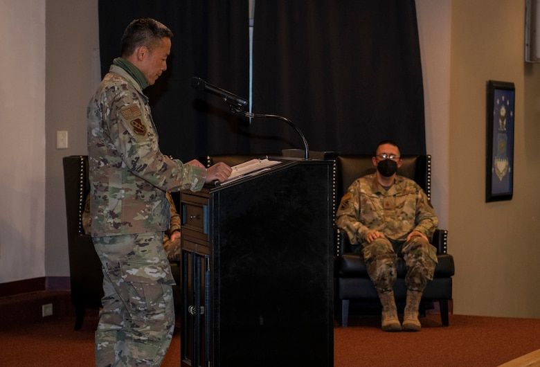 Col. Ed Sumangil, 7th Bomb Wing commander, left, speaks during the assumption of the stole ceremony for Chaplain (Maj.) Gabriel Rios, 7th Bomb Wing wing chaplain, right, at Dyess Air Force Base, Texas, Mar. 24, 2021.