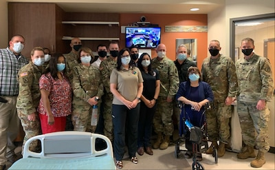 """CRDAMC team stands with TCC installation team at the tele-critical care services """"go-live"""" event April 1."""