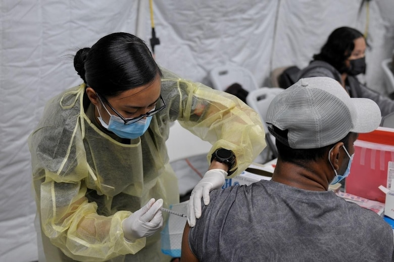 Sgt. Franchesca Esteban, assigned to 25th Infantry Division, administers a COVID-19 Vaccine in support of the Commonwealth Healthcare Corporation (CHCC) COVID-19 Vaccination team at the Medical Care and Treatment Site (MCATS).