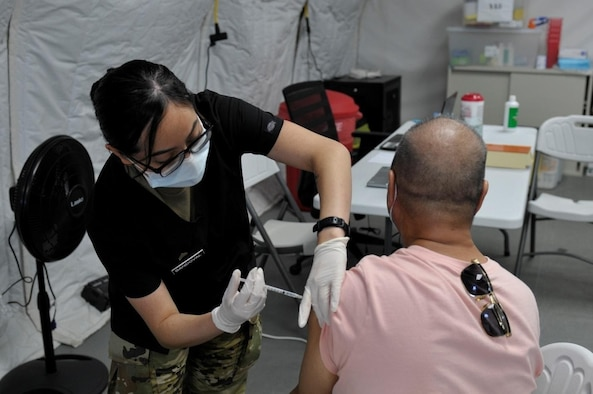 Sgt. Diana Sandoval, assigned to 25th Infantry Division, administers a COVID-19 Vaccine in support of the Commonwealth Healthcare Corporation (CHCC) COVID-19 Vaccination team at the Medical Care and Treatment Site (MCATS).