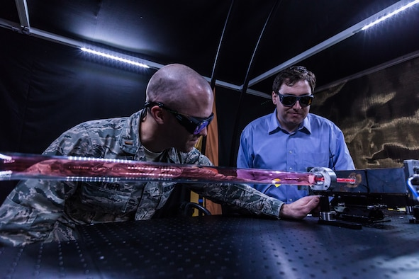 Air Force Research Laboratory physicist 1st Lt. James Wymer tests a laser source in one of the Directed Energy Directorate's high power microwave labs while fellow researcher Alex Englesbe looks on. (Courtesy photo/AFRL)