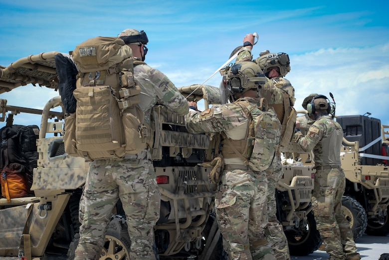 U.S. Air Force Airmen assigned to the 36th Contingency Response Group, unload training gear during a field training exercise on Wake Island, Western Pacific, April 2, 2021.