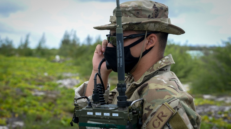 U.S. Air Force Airman 1st Class Brayan Rivera-Donalds, radio frequency transmission systems technician assigned to the 644th Combat Communications Squadron, checks the communication signal to the aircrew during a field training exercise on Wake Island, Western Pacific, April 2, 2021.