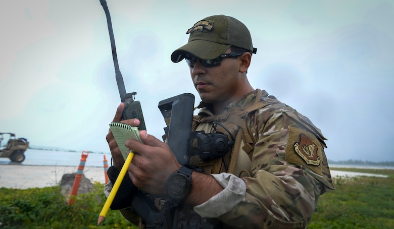 U.S. Air Force Senior Airman Juan Ordonez, fly away security team member assigned to the 736th Security Forces Squadron, calls in a nine line report during a field training exercise on Wake Island, Western Pacific, April 2, 2021.