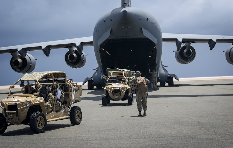 U.S. Air Force Airmen assigned to the 36th Contingency Response Group, prepare to off load a C-17 Globemaster III assigned to the 8th Airlift Squadron, McChord Air Force Base, Wash. during a field training exercise on Wake Island, Western Pacific, April 2, 2021.