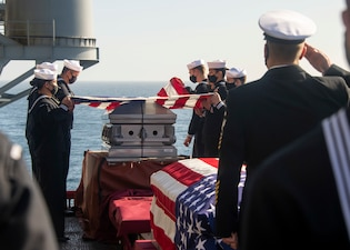 USS Essex (LHD 2) conducts a burial at sea in the Pacific Ocean.