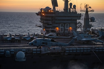 A Sea Hawk helicopter prepares to land aboard USS Dwight D. Eisenhower (CVN 69) in the Red Sea.