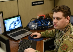 Senior Airman Austin Freeman, a cyber transport specialist for the 403rd Communications Flight at Keesler Air Force Base, Miss., works on training during the Unit Training Assembly March 14, 2021. Freeman deals largely with network-related technology in the flight's effort to preserve connectivity and keep the mission of the 403rd Wing going. (U.S. Air Force photo by Staff Sgt. Kristen Pittman)