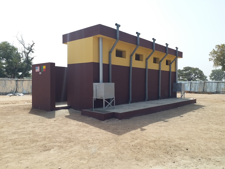 A multi-compartment ventilated improved pit latrine is seen here at the newly constructed health clinic site in the village of Godjekoara, Benin in Africa. The health clinic was one of two recently completed in the region by the U.S. Army Corps of Engineers, Europe District in support of AFRICOM and coordinated with the U.S. State Department. Both clinics feature similar latrine facilities, which are a type of specially designed latrines built in areas where is no dependable supply of piped water that feature ventilation pipes with built-in fly screens to reduce the gathering of flies and other disease carrying insects that often gather at restroom sites and are laid out to reduce lingering odors associated with their use.