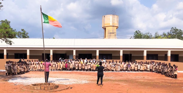 Dozens of students pose in front of a recently completed school facility in Kpomasse, Benin in Africa. The school is one of three school projects in the country recently constructed by the U.S. Army Corps of Engineers, Europe District. The U.S. Army Corps of Engineers, Europe District manages the constructions of Humanitarian Assistance projects like this one and others in Benin and in several other countries throughout Africa in support of AFRICOM and coordinated closely with the U.S. State Department.