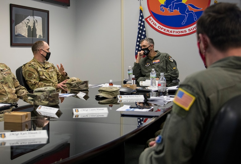 U.S. Air Force Col. Matthew Leard, 97th Air Mobility Wing (AMW) commander, speaks during a brief to Maj. Gen. Craig Wills, 19th Air Force commander, March 29, 2021, at Altus Air Force Base, Oklahoma. During Wills' visit to the 97 AMW, he received multiple briefings explaining the updates and changes being made across the wing. (U.S. Air Force photo by Airman 1st Class Amanda Lovelace)