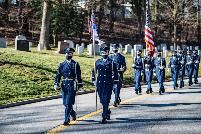 U.S. Air Force 1st Lt. Ngoc-Anh Huynh, United States Air Force Honor Guard Operations Support Flight commander, serves as Commander of Troops of the United States Honor Guard procession as part of modified military funeral honors with funeral escort for U.S. Air Force Lt. Col. Bruce Burns in Section 82 of Arlington National Cemetery, Arlington, Virginia, March 22, 2021. Burns served in the Air Force from 1962 to 1982. His spouse, Janet Burns, received the flag from his service. The funeral was an historic occasion for the United States Honor Guard, with the largest female presence on a pallbearers team in Air Force history. (U.S. Army photo by Elizabeth Fraser)