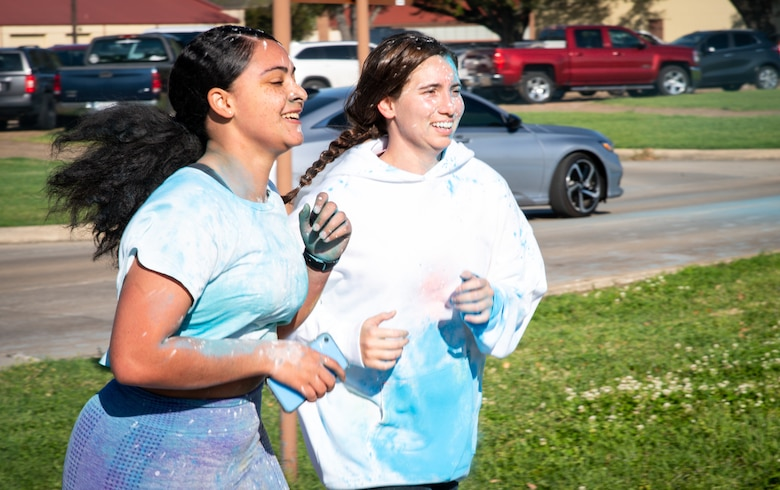 Participants in the Sexual Assault Awareness Month 5K run to the finish line at Barksdale Air Force Base, Louisiana, April 2, 2021.
