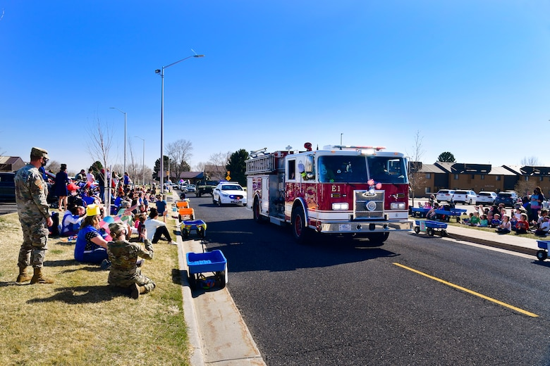 """Emergency vehicles sounding sirens and flashing lights during the """"Operation Bunny Trail"""" Easter parade."""