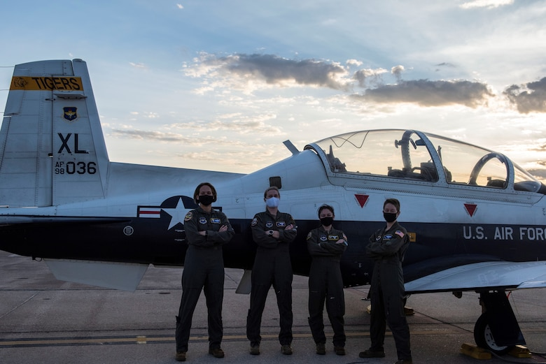 Pictured (Left to Right): Col. Cary Jones, Capt. Susan Jennie, Capt. Melany Delgado, and Maj. Emily Brown stands in front of a T-6 Texan II. The T-6 is the first aircraft all pilots must fly during there training during their time at Laughlin.(Courtesy photo taken by 2nd Lt. Esther Min)