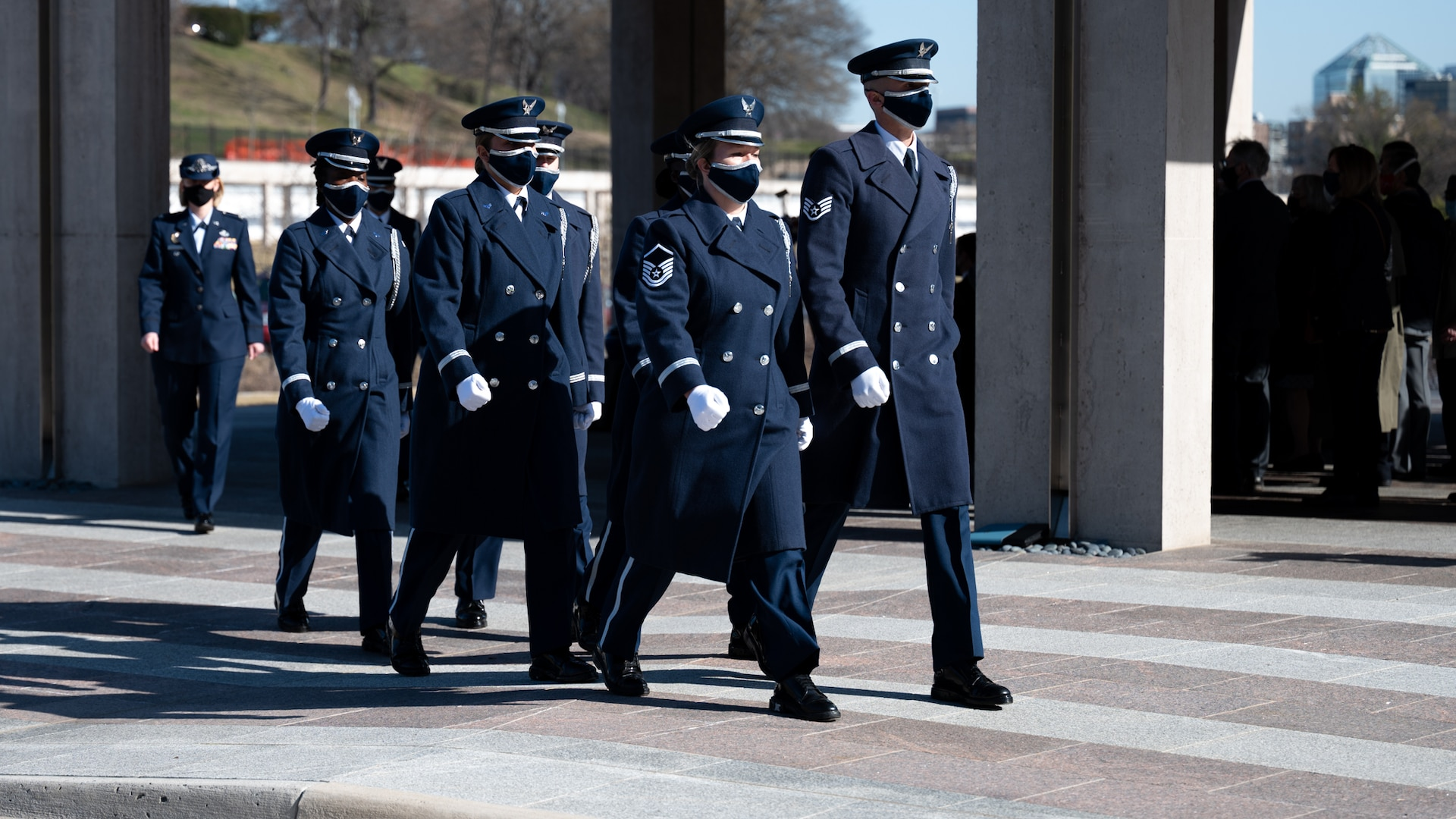 United States Honor Guard Pallbearers march in formation as part of modified military funeral honors with funeral escort for U.S. Air Force Lt. Col. Bruce Burns in Section 82 of Arlington National Cemetery, Arlington, Virginia, March 22, 2021. Burns served in the Air Force from 1962 to 1982. His spouse, Janet Burns, received the flag from his service. The funeral was an historic occasion for the United States Honor Guard, with the largest female presence on a pallbearers team in Air Force history. (U.S. Air Force photo by Staff Sgt. Stuart Bright)