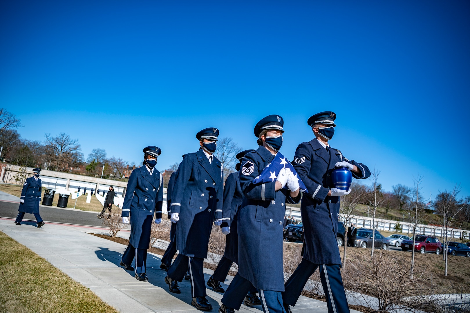 Master Sgt. Kierston Mair, flight chief, pallbearers, carries a flag with the United States Honor Guard Pallbearers as part of modified military funeral honors with funeral escort for U.S. Air Force Lt. Col. Bruce Burns in Section 82 of Arlington National Cemetery, Arlington, Virginia, March 22, 2021. Burns served in the Air Force from 1962 to 1982. His spouse, Janet Burns, received the flag from his service. The funeral was an historic occasion for the United States Honor Guard, with the largest female presence on a pallbearers team in Air Force history.  (U.S. Army photo by Elizabeth Fraser)