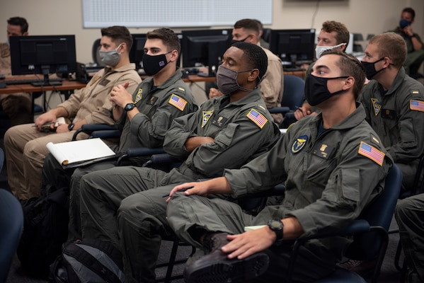 TraCORPUS CHRISTI, Texas (Oct. 30, 2020) The first students enrolled in Naval Aviation Training Next-Project Avenger receive briefings from dedicated instructors. Project Avenger is a prototype syllabus designed to train student naval aviators to a greater level of proficiency in a shorter period of time than the traditional syllabus to increase fleet aviator availability. (U.S. Navy photo by Anne Owens/Released)