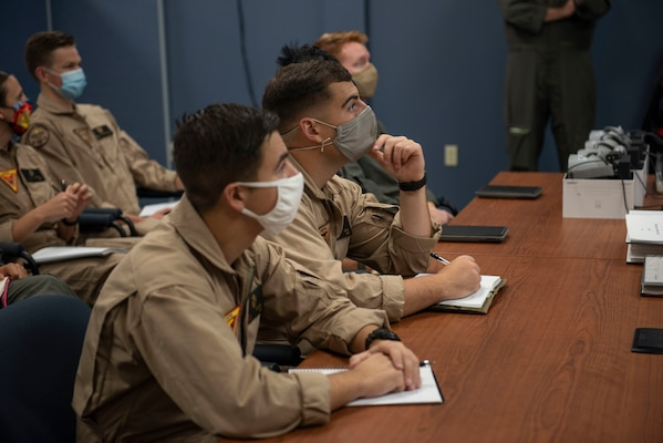 CORPUS CHRISTI, Texas (Oct. 30, 2020) The first students enrolled in Naval Aviation Training Next-Project Avenger receive briefings from dedicated instructors. Project Avenger is a prototype syllabus designed to train student naval aviators to a greater level of proficiency in a shorter period of time than the traditional syllabus to increase fleet aviator availability. (U.S. Navy photo by Anne Owens/Released)