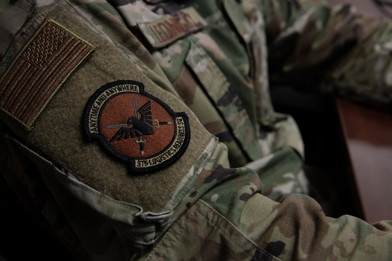 A 375th Logistics Readiness Squadron patch affixed to the uniform of Airman 1st Class Kyle Lednicky, 375th Logistics Readiness Squadron logistics planner, on Scott Air Force Base, Ill., April 2, 2021. The 375h LRS provides logistic support to Scott AFB and tenant units to enable rapid global mobility. (U.S. Air Force photo by Shannon Moorehead)