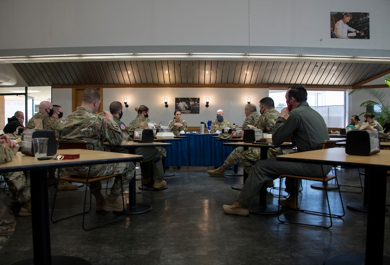 "U.S. Air Force Chief Master Sgt. Kristina L. Rogers, 19th Air Force command chief, and Chief Master Sgt. Randy Kay II, 97th Air Mobility Wing command chief, engage with A Chief and Senior NCO during a mentorship lunch on March 29, 2020, in Hangar 97 at Altus Air Force Base, Oklahoma. During the lunch, Rogers spoke about ""hot topics"" such as the new hair regulations and fitness testing. (U.S. Air Force photo by Airman 1st Class Amanda Lovelace)"