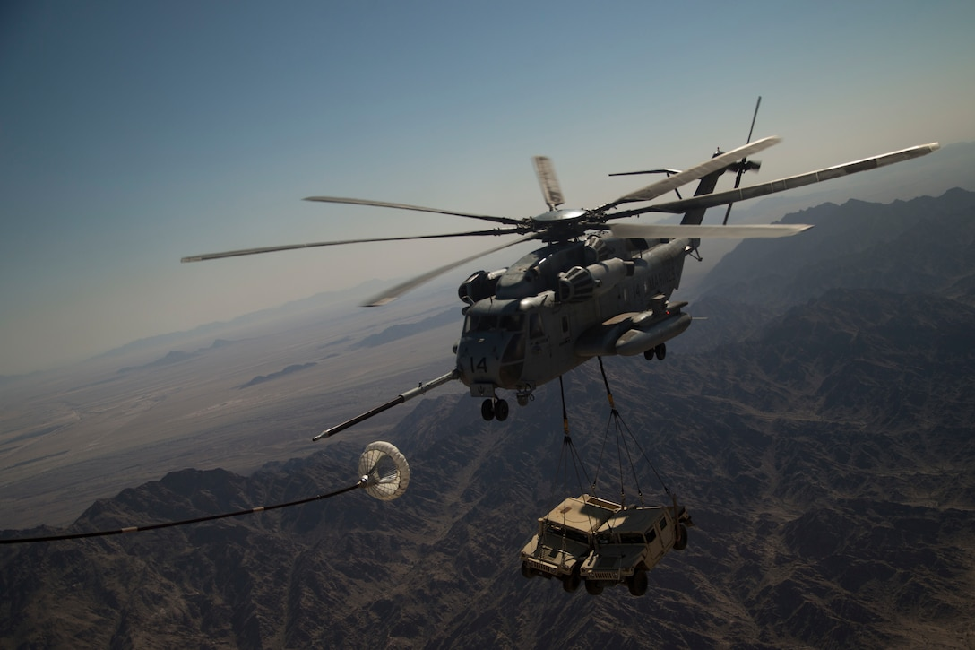 A U.S. Marine Corps CH-53E Super Stallion executes an air to air refuel during a heavy lift exercise near Yuma, Ariz., March 31.